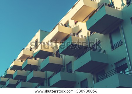 Balconies of modern hotel on the blue sky background #530930056