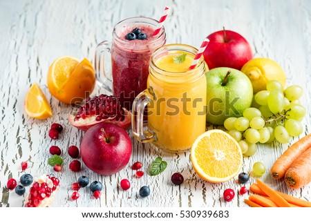 Berry and vegetables  smoothie, healthy juicy vitamin drink diet or vegan food concept, fresh vitamins, homemade refreshing fruit beverage #530939683