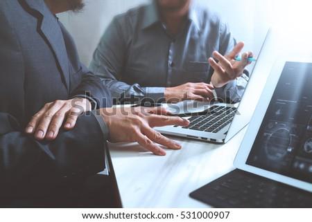 Business team meeting. Photo professional investor working new start up project. Finance task.Digital tablet docking keyboard laptop computer smart phone using, filter film effect #531000907
