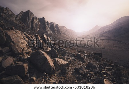 Parched, rocky desert landscape in southern Morocco Royalty-Free Stock Photo #531018286