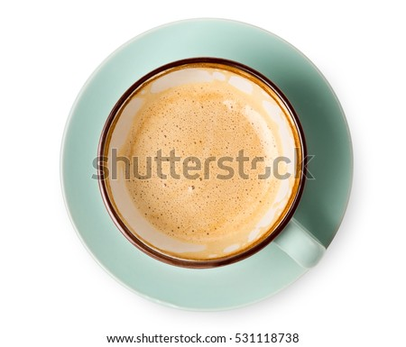 Cappuccino or latte with frothy foam, blue coffee cup top view closeup isolated on white background. Cafe and bar, barista art concept. #531118738