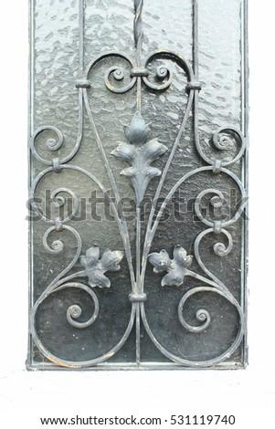 wrought iron, flowery window lattice #531119740