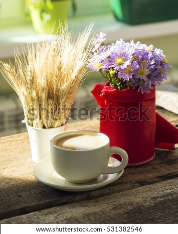 sunny morning breakfast table with a cup of coffee, bouquet of blue flowers muffins and old camera. place for lovely messages. soft focus image