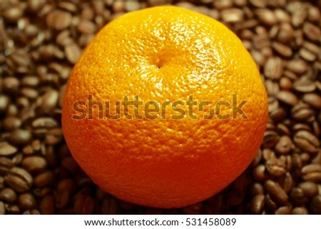 Orange on the background of coffee creative background cappuccino  #531458089