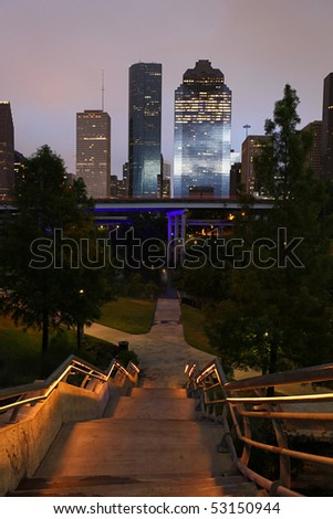 Descending stairs with path to the Houston Skyline