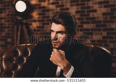 Portrait of ponder businessman in suit thinking about future #531511603
