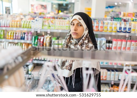 Hijab Arab Muslim lady doing shopping in big modern city mall #531629755