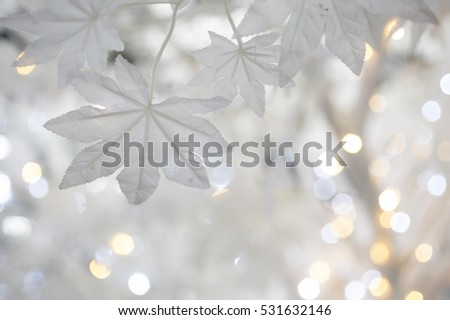Christmas tree background with white artificial maple leaves #531632146