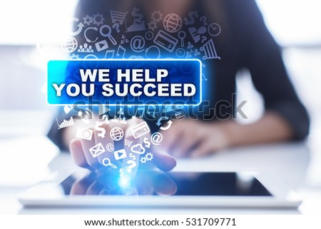 Woman is using tablet pc, pressing on virtual screen and selecting we help you succeed. #531709771