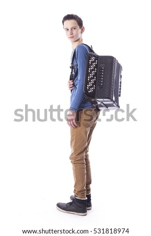 teenage caucasian boy carries accordion in studio with white background #531818974
