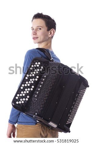 teenage caucasian boy carries accordion in studio with white background #531819025
