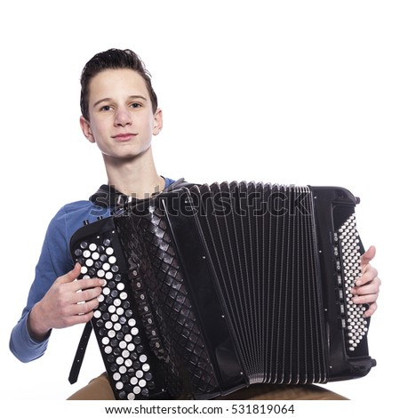 teenage caucasian boy plays the accordion in studio with white background #531819064