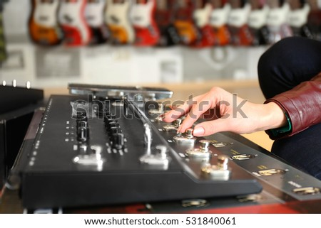 Female hand on audio control panel #531840061