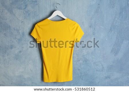Blank yellow t-shirt on grunge background #531860512