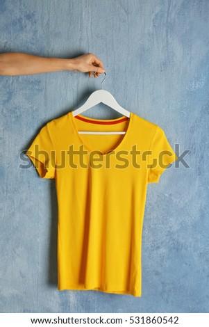Blank yellow t-shirt on grunge background #531860542