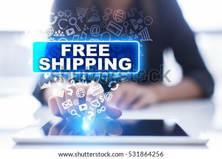 Woman is using tablet pc, pressing on virtual screen and selecting free shipping. #531864256