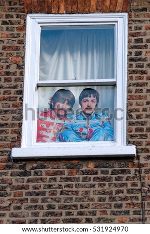 YORK, UK - JUNE 29, 2016: A printed picture of the Beatles on a window #531924970