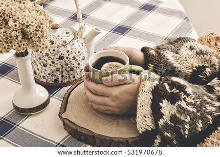 girl holds green mug with tea in hands #531970678