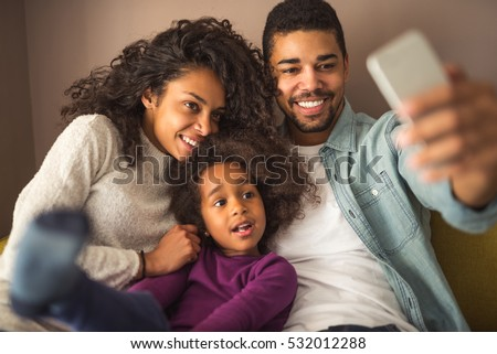 Happy african american family making  a selfie at home. #532012288