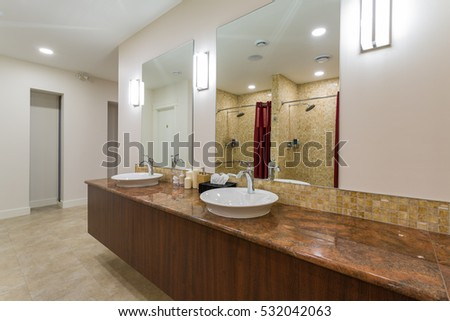 Spa or sauna modern bathroom with shower, white sinks and stone counter top. #532042063