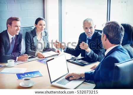 Businesspeople discussing together in conference room during meeting at office Royalty-Free Stock Photo #532073215