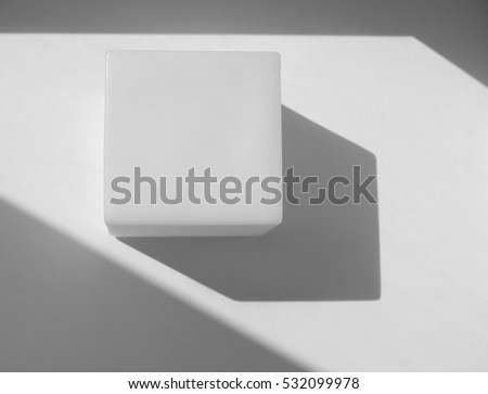 White cube on white background with shadows