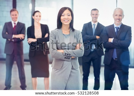 Portrait of business people standing with arms crossed in office #532128508