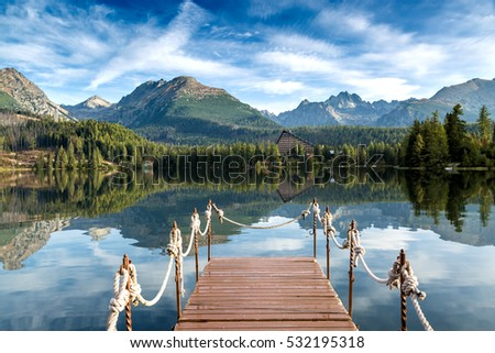 Unusual lake in the Slovakian Tatras. Famous place of rest and relaxation in the mountains. #532195318