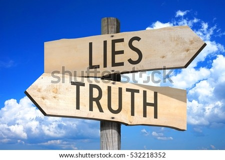 Lies, truth - wooden signpost Royalty-Free Stock Photo #532218352