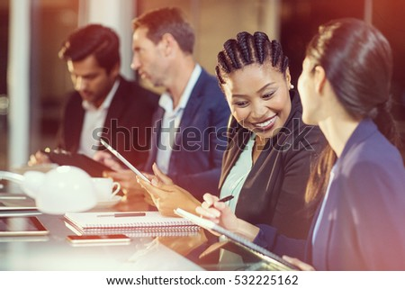 Businesswoman interacting withcolleague in office #532225162