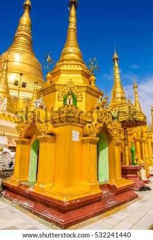 YANGON, MYANMAR - AUG 24, 2016: Surroundings of the  Shwedagon Pagoda, a gilded stupa on the Singuttara Hill, Kandawgyi Lake, Yangon, Myanmar #532241440