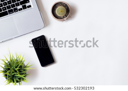 White office desk table with laptop, smartphone, cactus, and plant. Top view with copy space, flat lay, 2017 #532302193