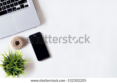 White office desk table with laptop, smartphone, rope, and plant. Top view with copy space, flat lay, 2017 #532302205