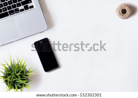 White office desk table with laptop, smartphone, rope, and plant. Top view with copy space, flat lay, 2017 #532302301