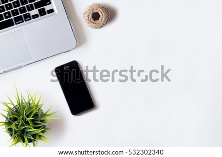 White office desk table with laptop, smartphone, rope, and plant. Top view with copy space, flat lay, 2017 #532302340