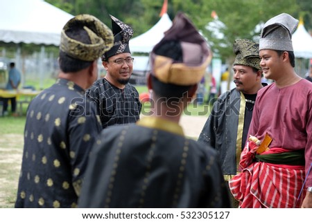 Negeri Sembilan, Malaysia - 14th December 2014 : A group of malay men dressed in a traditional malay warrior armed with bow, arrow and keris during an event Temasya Zaman Kegemilangan Empayar Melayu #532305127