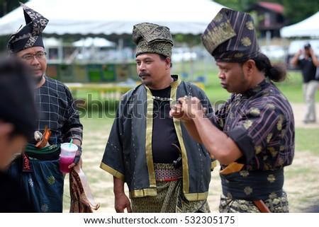 Negeri Sembilan, Malaysia - 14th December 2014 : A group of malay men dressed in a traditional malay warrior armed with bow, arrow and keris during an event Temasya Zaman Kegemilangan Empayar Melayu #532305175