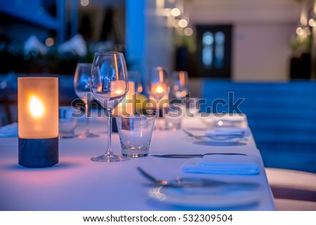 Dinner table overlooking the sunset #532309504