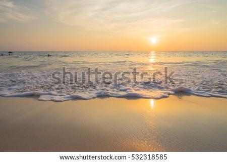 Golden sunrise sunset over the sea ocean waves #532318585