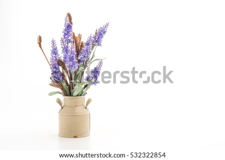 statice and caspia flower in vase on the table #532322854