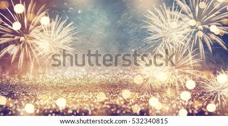 Vintage gold and green Fireworks and bokeh in New Year eve and copy space. Abstract background holiday. Royalty-Free Stock Photo #532340815