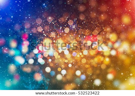 abstract blurred of blue and silver glittering shine bulbs lights background:blur of Christmas wallpaper decorations concept.xmas holiday festival backdrop:sparkle circle lit celebrations display . Royalty-Free Stock Photo #532523422