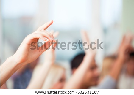 Raising Hands for Participation Royalty-Free Stock Photo #532531189