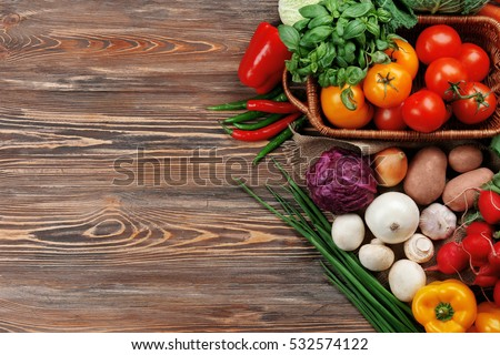 Fresh vegetables on wooden background #532574122
