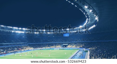 Panoramic view of modern stadium during football match Royalty-Free Stock Photo #532669423