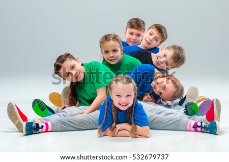 The kids dance school, ballet, hiphop, street, funky and modern dancers on gray studio background. Sublings day. #532679737