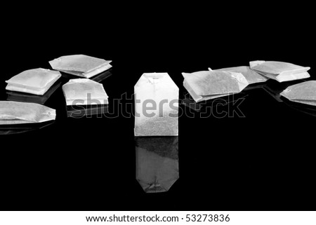 The tea bags isolated on black. #53273836