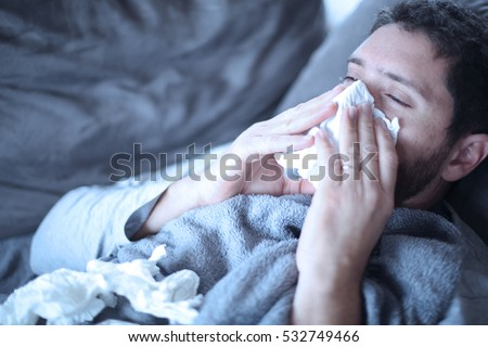Man sick of the flu Royalty-Free Stock Photo #532749466