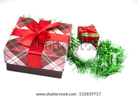 Gift box and golf ball with christmas ornament are on white background