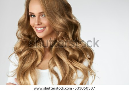 Beautiful Curly Hair. Smiling Girl With Healthy Wavy Long Blonde Hair. Portrait Happy Woman With Beauty Face, Sexy Makeup And Perfect Hair Curls. Volume, Hairstyle, Hairdressing Concept. High Quality #533050387